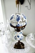 Antique paraffin lamp with china lampshade painted blue and white