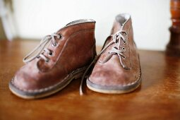 Child's shoes on wooden surface