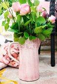 Pink roses in ornate jug