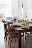 Wooden, Scandinavian-style chairs around set dining table