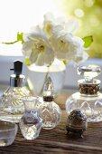 Various crystal perfume bottles and vases