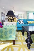Living room in style and color mix with sofas, coffee table and table lamp