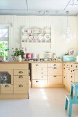 Bright, country-house-style kitchen with L-shaped counter and island counter