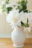 White peonies in porcelain vase