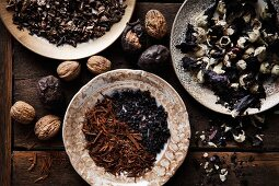 Various natural materials for dying eggs: dried bilberries, walnuts, redwood, mallow and hollyhock flowers