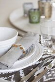 Place setting with white china plate and linen napkin
