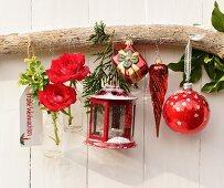 Christmas arrangement with lantern, flowers & baubles