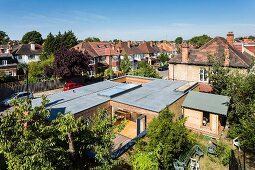 View down onto flat-roofed house with courtyard in residential area