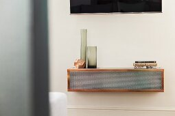 Smoked glass vases on wall-mounted shelf