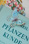 Paper butterfly on antiquarian plant book