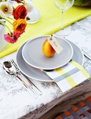 Name tag hung on pear on grey plate