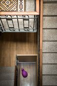 Traditional stairwell with terrazzo treads and view of purple animal sculpture