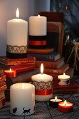 Candles decorated with ribbons and trim for Halloween