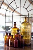 Vintage apothecary bottles of various sizes
