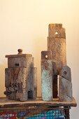 Still-life arrangement of rustic, vintage objects on wooden plank shelf