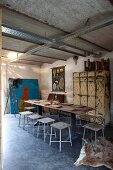 Artist's studio with simple stools, table set with wooden boards and vintage metal lockers