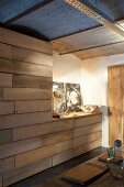 Fitted cupboards with horizontal wooden board fronts in artistic interior