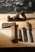 Old tools on wooden surface