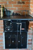 Black, vintage stove integrated in brick counter