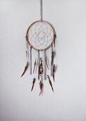 Hand-crafted dreamcatcher hanging on wall