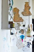Drawings pinned to wall and vintage pendant lamp