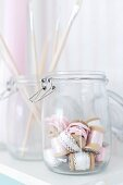 Storage jars holding paintbrushes and ribbons