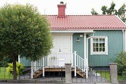 Small, Swedish country house with veranda and lattice windows