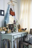 Perfume bottles and mirror on romantic dressing table