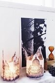 Hand-crafted paper candle lanterns with pictures of buildings