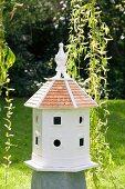 White bird nesting box in garden