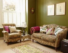 Green patterned sofa set with scatter cushions against green walls