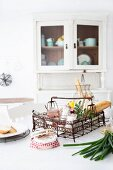 Country-house-style kitchen with groceries and utensils in vintage wire basket