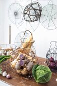 Various wire baskets used to store vegetables in kitchen