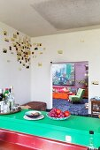 View into living room from loft-apartment kitchen with artistic wall decoration