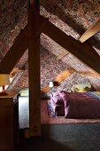 Attic bedroom with William Morris wallpaper
