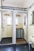 Shower cubicle and vintage chest of drawers in loft-apartment bathroom
