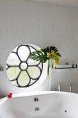 Bathtub below circular, rosette window