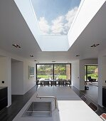 Point 7, Winchester, United Kingdom. Architect: Dan Brill Architects, 2014. Open-plan interior with skylight over kitchen island with dining area in background