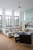 Bright interior with sofa, retro leather armchair and delicate coffee tables