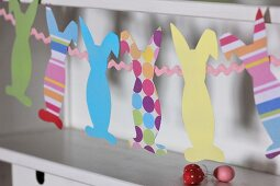 Easter garland of colourful, construction paper bunnies