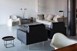 Lounge area with designer furniture in restored loft apartment