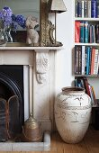 Antique floor vase next to fireplace