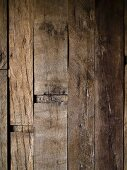 Wooden wall made from weathered, reclaimed beams