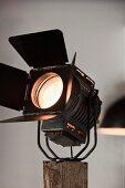 Studio light mounted on wooden post