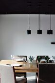 Pendant lamps above set modern dining table