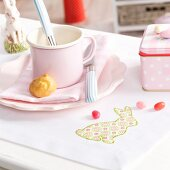 Easter breakfast place setting on place mat with iron-on motif