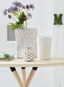 DIY knitted vases - vases with knitted covers on side table