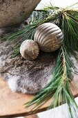 Vintage Christmas baubles and pine sprig on fur