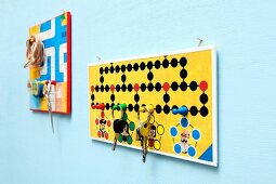 Key holder and pin board creatively crafted from board games