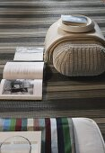 Wicker pouffe and open book on sisal rug